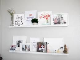 home white art shelves in the living room positively oakes