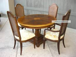 dark brown polished wooden dining chairs with high backrest and
