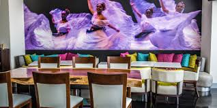 murals and drapery nod to twirling jarocha dancers in hotel indigo