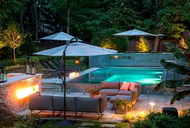modern pool design ideas with stone wall and plants tile edge