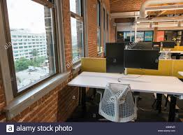 trendy modern open concept loft office space with big windows