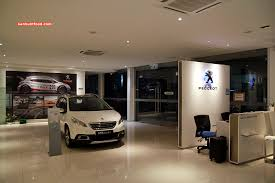 peugeot car showroom ken hunts food going the extra mile peugeot a driving experience