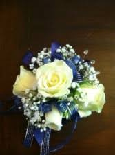 royal blue corsage roses and white orchids wristlet corsage in tillamook or
