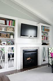 fireplace built in cabinets iheart organizing diy fireplace built in tutorial