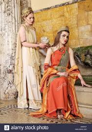 women in traditional roman clothing posing in temple stock photo