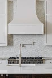 white kitchen cabinets with hexagon backsplash kitchen with marble hex tiles transitional