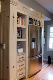 Kitchen Cabinets Refrigerator Surround by We Love The Storage Surrounding The Fridge Perfect For Cookbooks