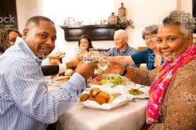 thanksgiving family friends gather for dinner at senior womans