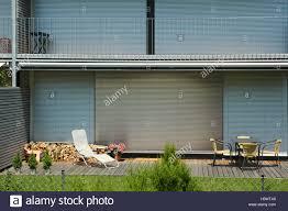 residence balcony garden terrace deck chair seat group stock