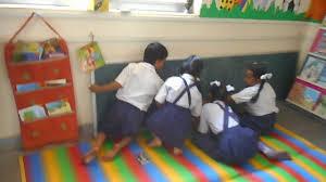 children performing different activities in reading corner goa 2