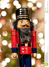 nutcracker in front of a christmas tree stock photos image 16772033