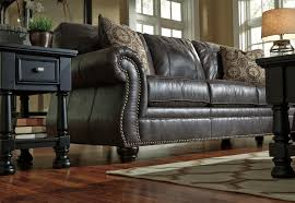 leather sofa with nailheads faux leather sofa with rolled arms and nailhead trim by benchcraft