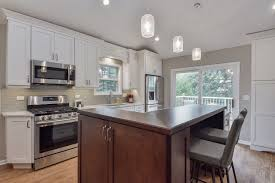 White Backsplash Kitchen Granite Countertop How To Sand And Stain Kitchen Cabinets White