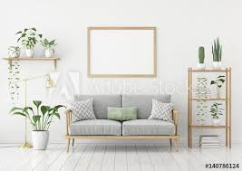 horizontal poster mock up with wooden frame sofa lamp and plants
