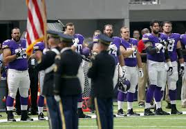 The National by On The Nfl Vikings Remain Standing During National Anthem