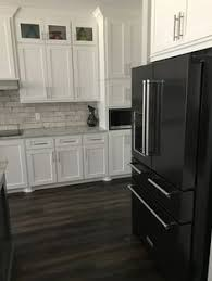 american flooring and cabinets mobile al how to decorate a kitchen with black appliances black appliances