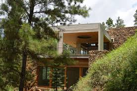 homes built into hillside grass roofed home built into slope uses hillside for cooling house