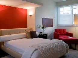using orange as the bedroom wall color to make it look fresher