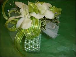 corsage prices wrist corsage with white orchids and green ribbon