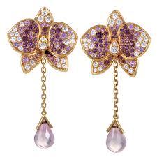 trendy gold earrings cartier caresse d orchidées par cartier diamond gemstone gold