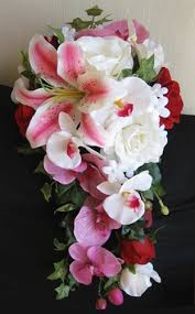 roses and lilies fuchsia orchids roses and lilies cascading bouquet