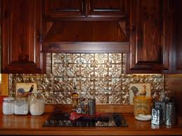 punched tin backsplash behind stove kitchen fan of