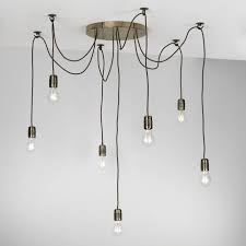 pendant light cluster with 7 lights hanging on braided cables