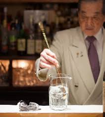 man holding martini punch mastering the martini with takao mori
