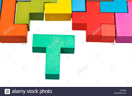T Shaped by T Shaped Block And Wooden Multicoloured Puzzle Isolated On White