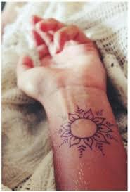 simple sun or flower wrist henna design ink henna