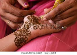 artist applying beautiful henna tattoo arabic stock photo