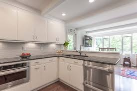 elmwood kitchen cabinets elmwood cabinetry white modern kitchen small kitchen stainless