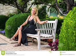 blonde woman sitting on bench fashion stock photo image 46526075