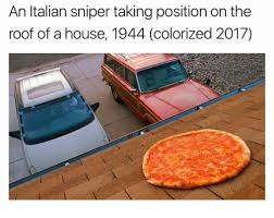 an italian sniper taking position on the roof of a house 1944