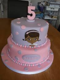 doc mcstuffins birthday cake children s birthday cakes a 7 and 9 inch two tier cake with doc