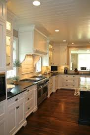Wood Kitchen Cabinets With Wood Floors by Would Love To Have A Kitchen With An Island And Black Marble