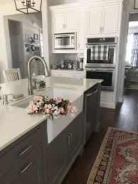 kitchens with different colored islands i like this faucet sink and island being a different color