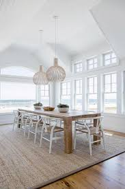 long solid wood dining table with white wishbone chairs cottage