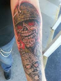 grenade and army skull by rocky fusco tattoos by rocky