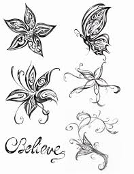 butterfly lily n cross tattoo on back shoulder photos pictures