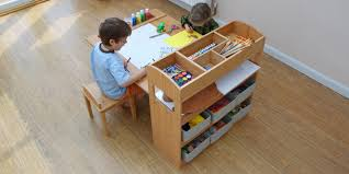 nice craft table with storage fulfilled kids tool and wooden floor