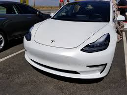 new tesla model 3 spotting shows possible automatic charge port