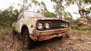 rusty pickup truck crane over rusty abandoned pickup truck stock video footage