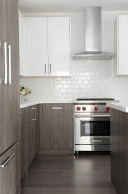 white upper cabinets and gray veneer lower cabinets contemporary