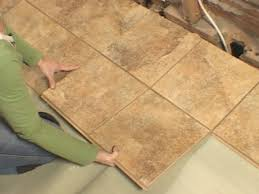 Laying Laminate Tile Flooring How To Install Snap Together Tile Flooring How Tos Diy