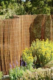 i like this idea camouflage chain link fence willow garden