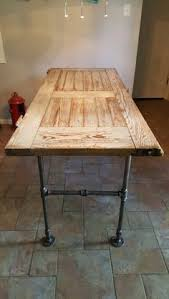barn door dining table old barn door turned into a table with pipes use old drawers