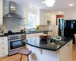 uba tuba granite with white cabinets white kitchen cabinets subway tile backsplash uba tuba granite