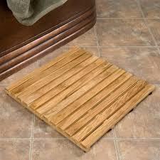 bathroom amazing shower with teak shower mat and tile flooring