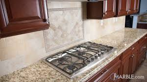light cherry kitchen cabinets and granite santa cecilia granite kitchen with cherry cabinets marble
